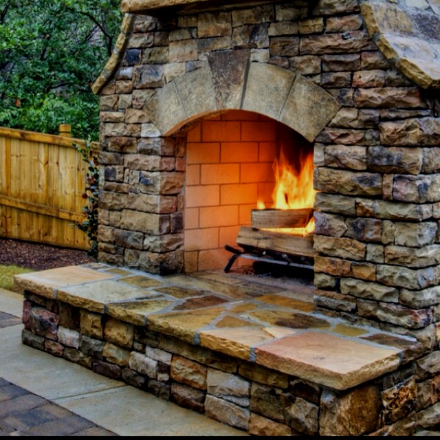 Prepare for texas pool season with these outdoor space for Pool with fireplace