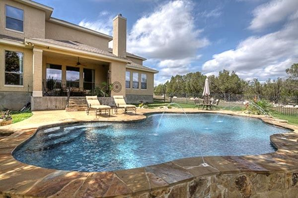 A freeform pool with recessed steps.